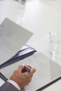 Businessman signing contract, close up